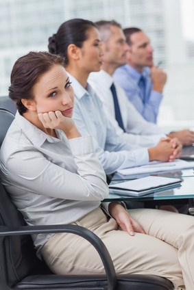 Woman bored at meeting